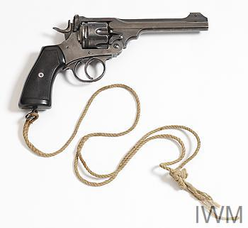 pistol with rough cord lanyard attached to lanyard ring.