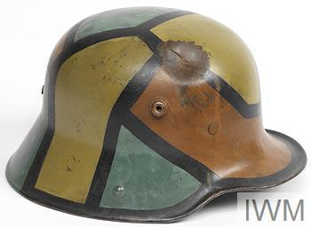 Model 1916 steel helmet, complete with leather three-pad liner attached to a leather headband. The inside is painted regulation dark apple green and externally is hand-painted in camouflage segments of red-brown, light-green and dark yellow, all outlined with a black border, 15mm in width.