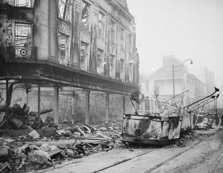 Damaged tram cars in one of the main streets in Sheffield after the raid on 12 December 1940.
