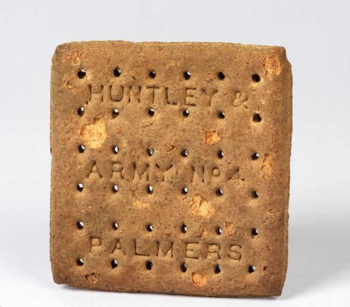 Square-shaped thick segmented biscuit (100mm x 100mm) bearing impressed inscription (in three lines): 'HUNTLEY & / ARMY No 4 / PALMERS '.