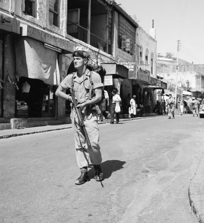 A foot patrol, of the 1st Battalion, The Kings Own Yorkshire Light Infantry, moving warily though a bazaar in Tawahi, Aden.