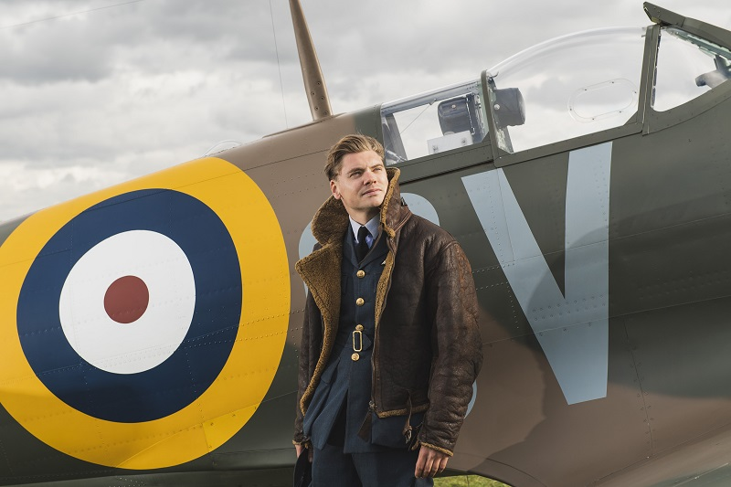 Actor in RAF flying jacket infront of N3200 Spitfire at IWM Duxford
