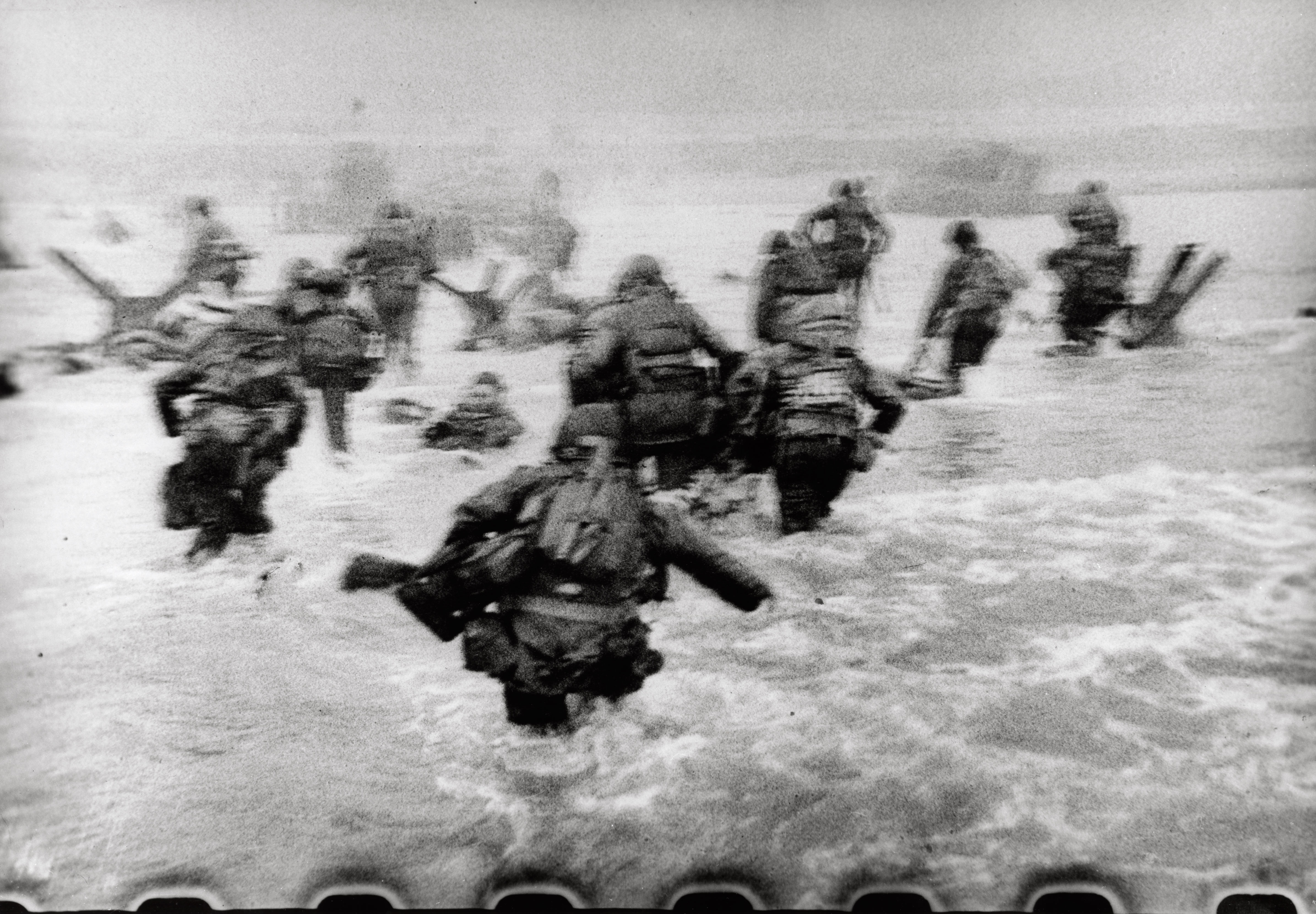 Robert Capa, [American troops landing on Omaha Beach, D-Day, Normandy, France], June 6 1944. © International Center of Photography/Magnum Photos