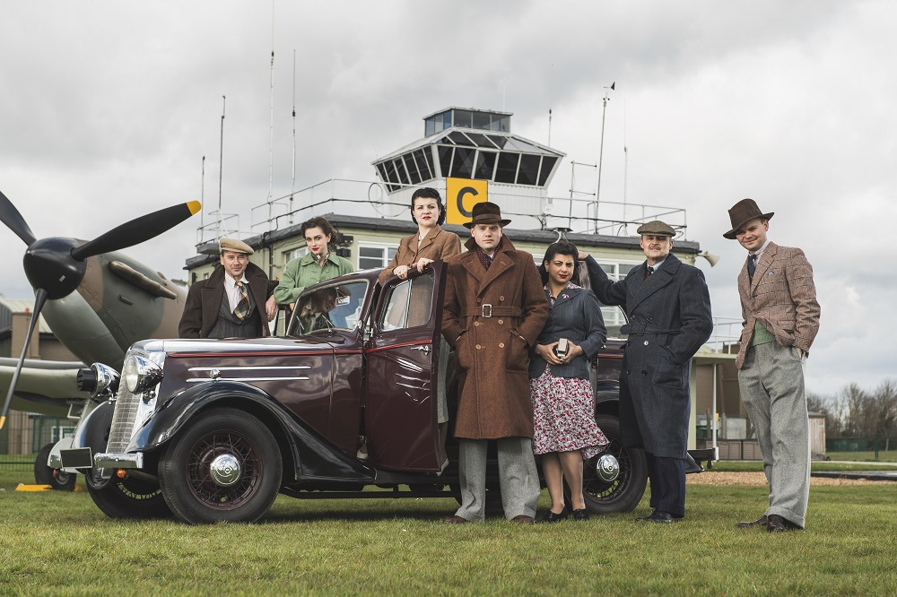 Actors and actresses in 1940s attire at IWM Duxford