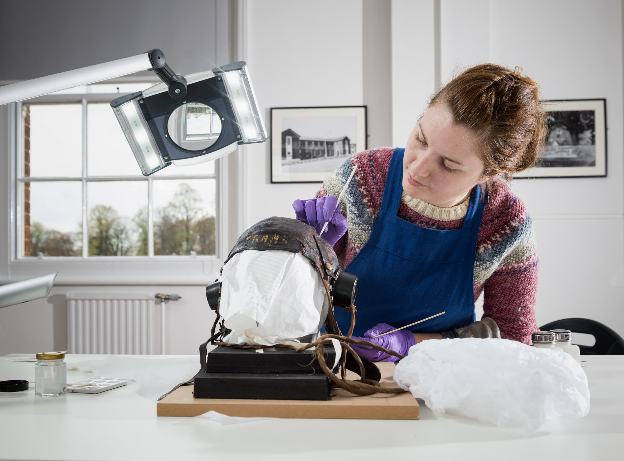 IWM's Project Conservator treating a SWW flying helmet in the conservation lab