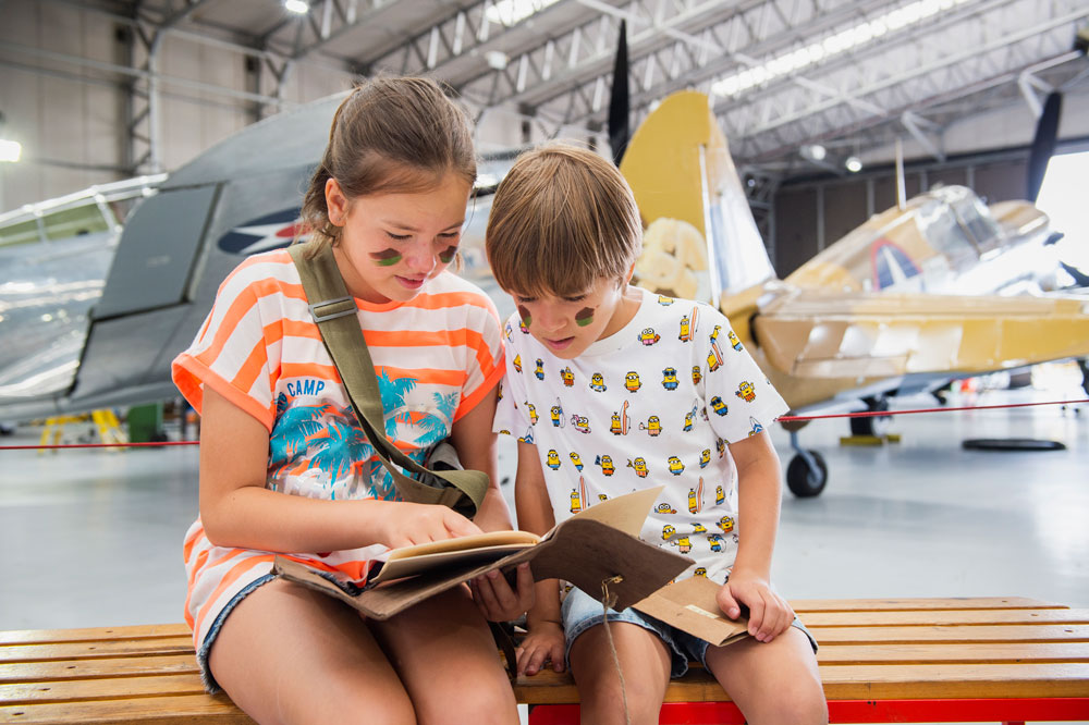 Two children enjoy Family Mission activity at IWM Duxford