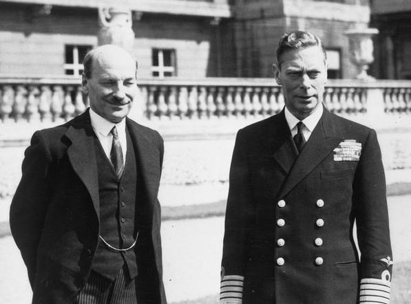 King George VI standing with the Labour Prime Minister, Clement Attlee. Black and white photograph Imperial War Museums
