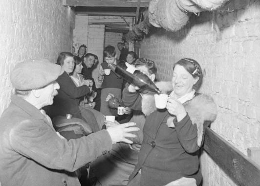 Sharing a drink in an air raid shelter
