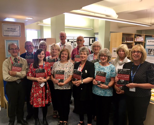 Trafford Local Studies staff and volunteers with copies of The Bravest Little Street in England