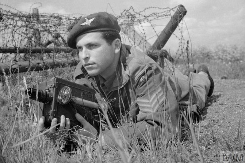 Cameramen in uniform: Sergeant Mike Lewis of the Army Film Unit posing with a De Vry, the camera most widely used by British combat cameramen.