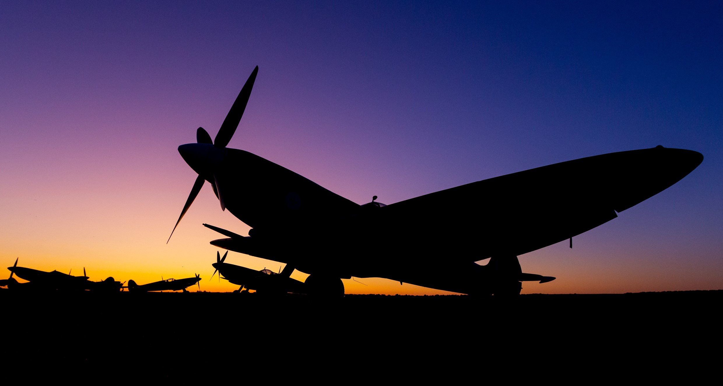 Spitfire silhouetted against the sunset