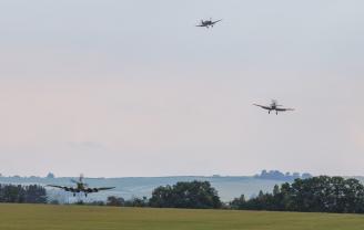 Spitfires landing at dusk, Duxford Air Shows