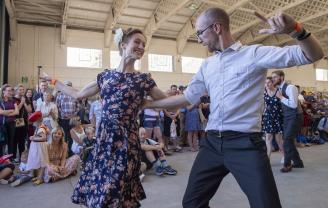 Couple dancing at Duxford Air Festival Showground