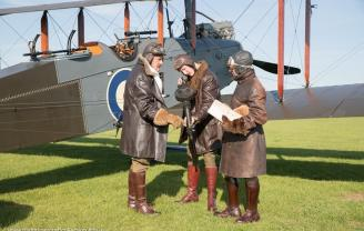 Three RFC pilots stand in front a DH9 bomber