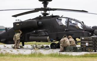 Apache attack helicopter with crew