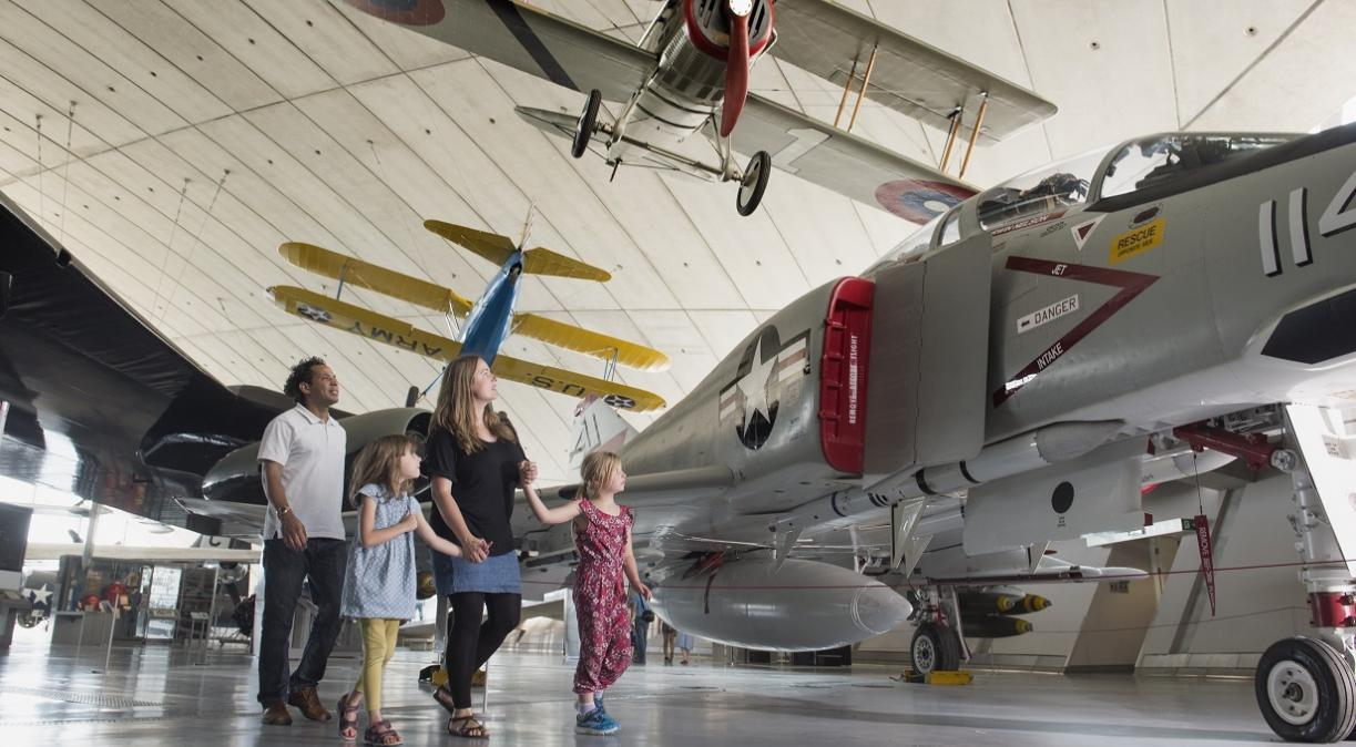 Family walking though the American Air Museum
