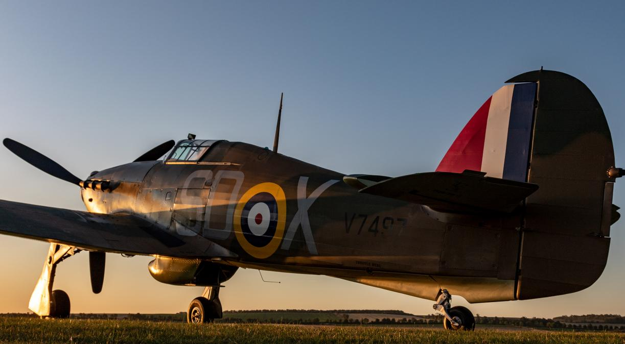 Sunrise over Duxford's Battle of Britain Airshow and a Hawker Hurricane.