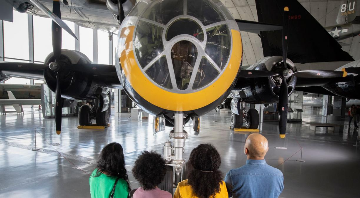 Family looking up at the B-29 Superfortress in the American Air Museum