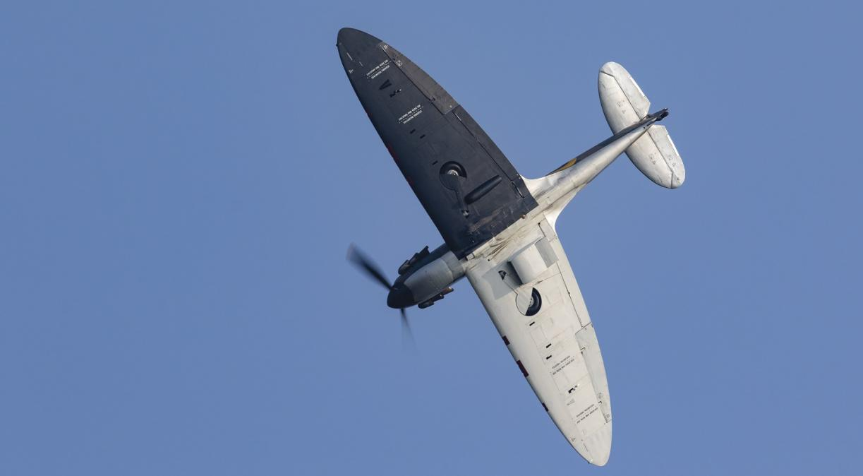 Spitfire N3200 black and silver against a blue sky