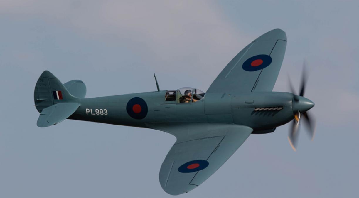 Spitfire PR MkIX against an evening sky