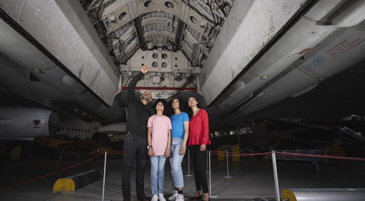 Family looking up into the Vulcan bomb bay