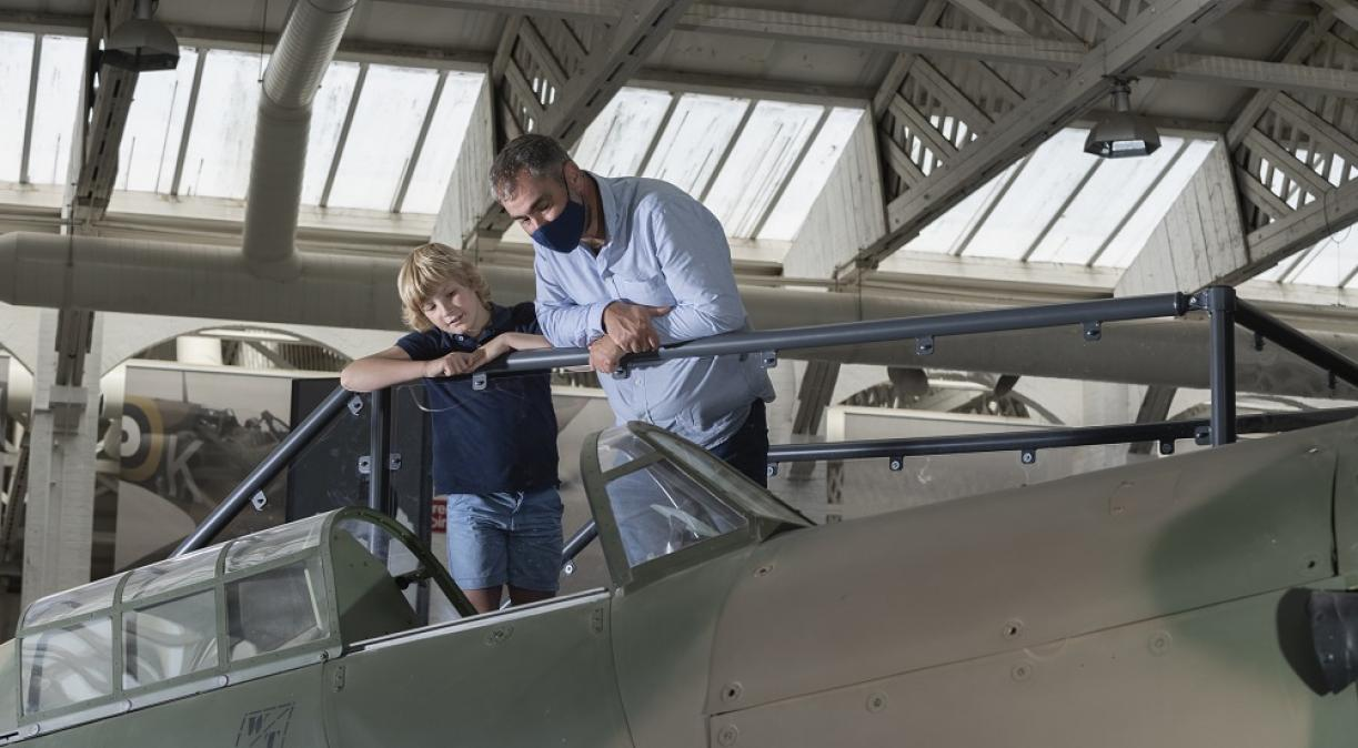 Father and son look at the Hurricane viewing platform in the Battle of Britain exhibition.
