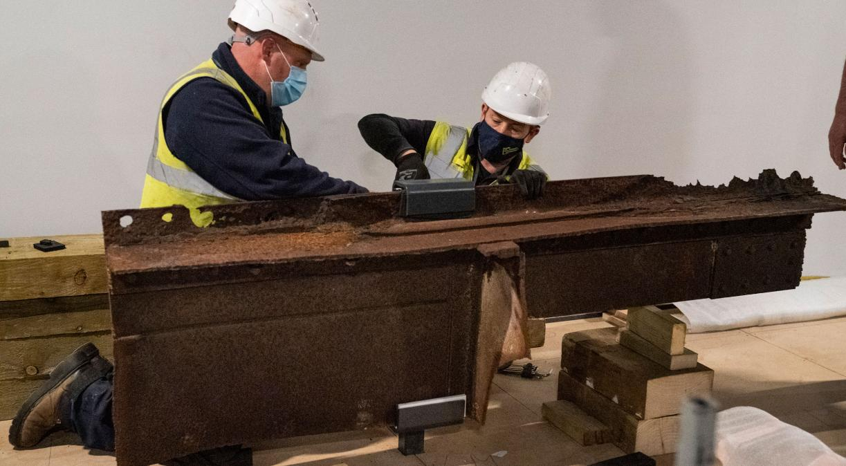 The first piece of the wreckage of the USS Arizona to leave the United States is installed in the Second World War Galleries