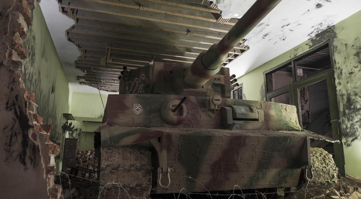 Image of a tank amongst rubble in the Land Warfare exhibition