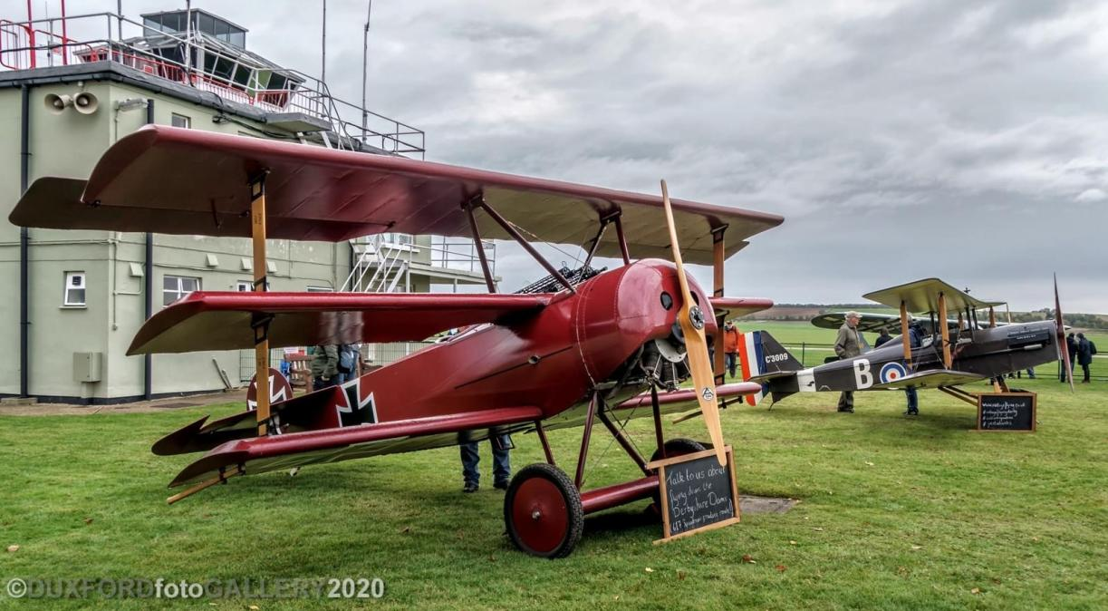 Fokker DR1 and SE5a static replicas outside at IWM Duxford