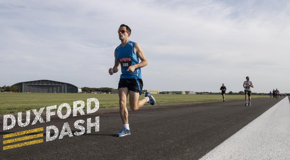 Duxford Dash runner conquering the runway at IWM Duxford