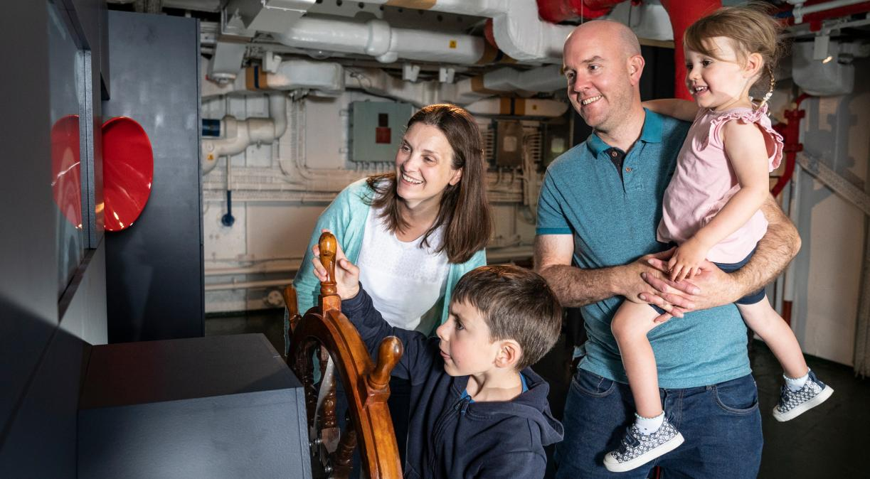 A family at the Lower Steering Position on board HMS Belfast