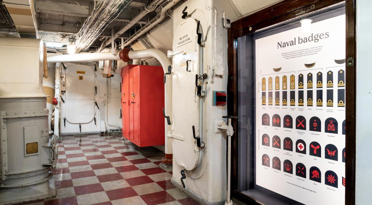 Naval badges on display near the Regulating Office on board HMS Belfast