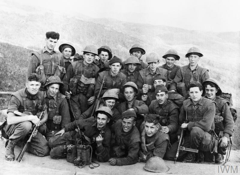 A group photo featuring a platoon on patrol during the Korean War