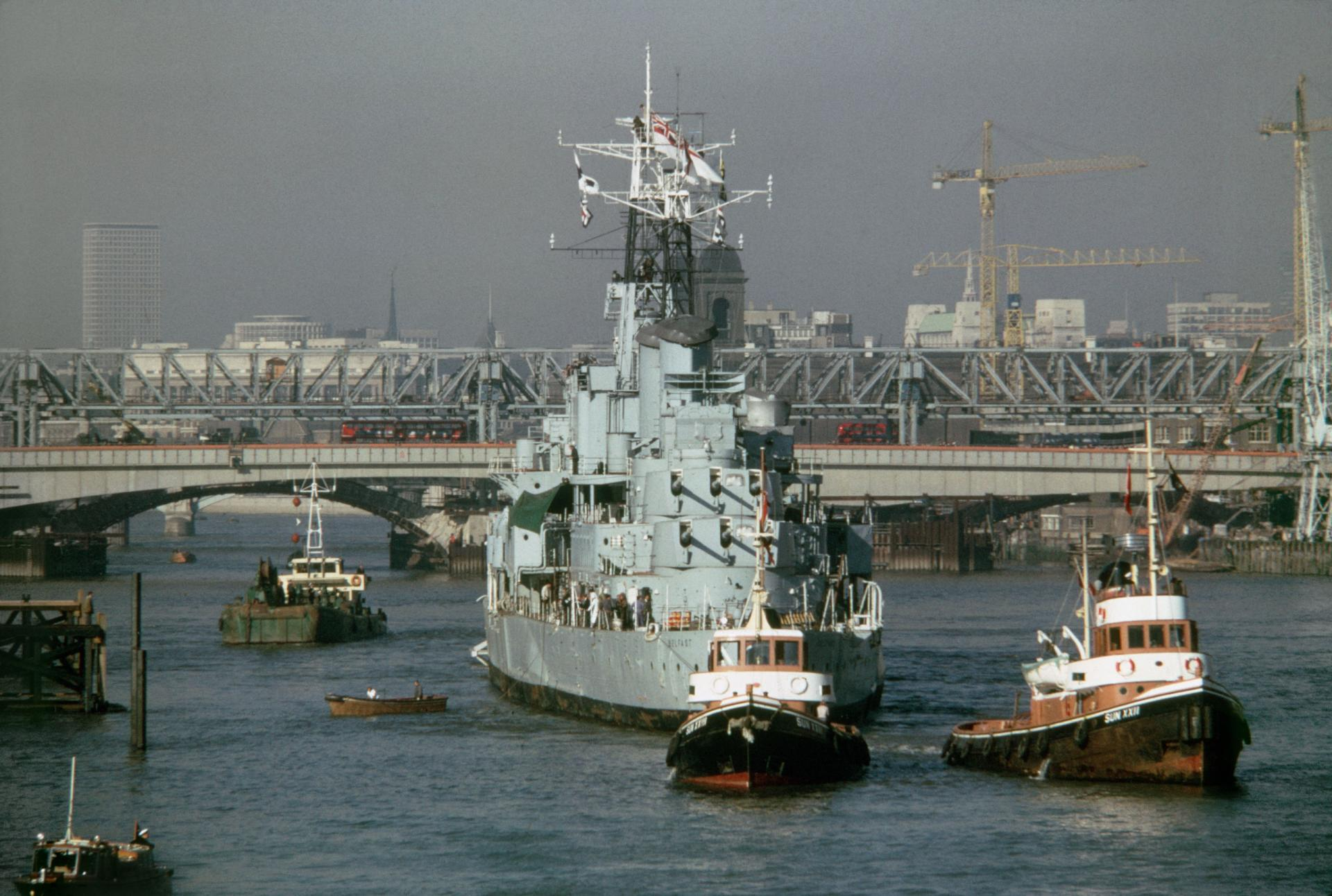 HMS Belfast arrives at the pool of London