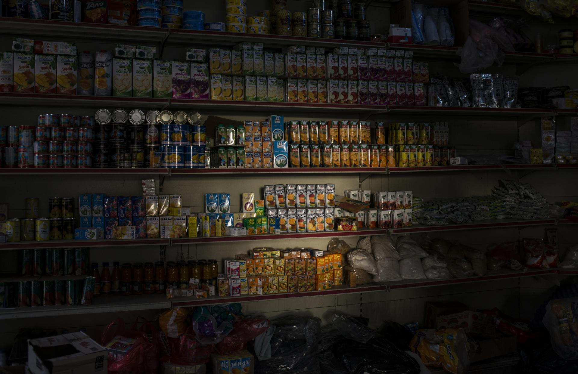 Light shines on goods in a convenience store in Sanaa, in north Yemen.