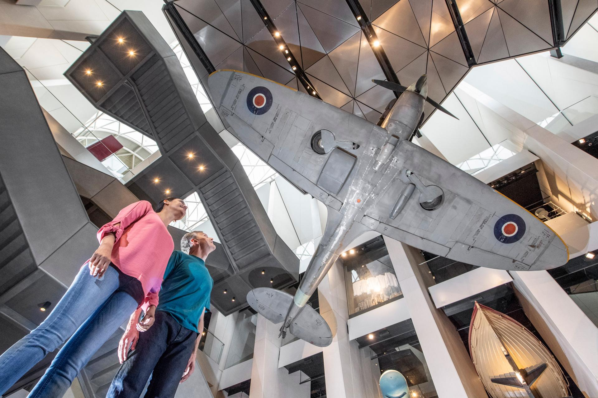 Visitors explore the Atrium at IWM London