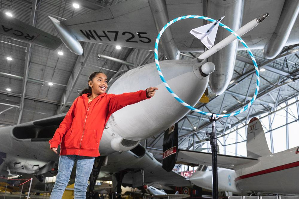 Girl taking part in Flight Academy at IWM Duxford