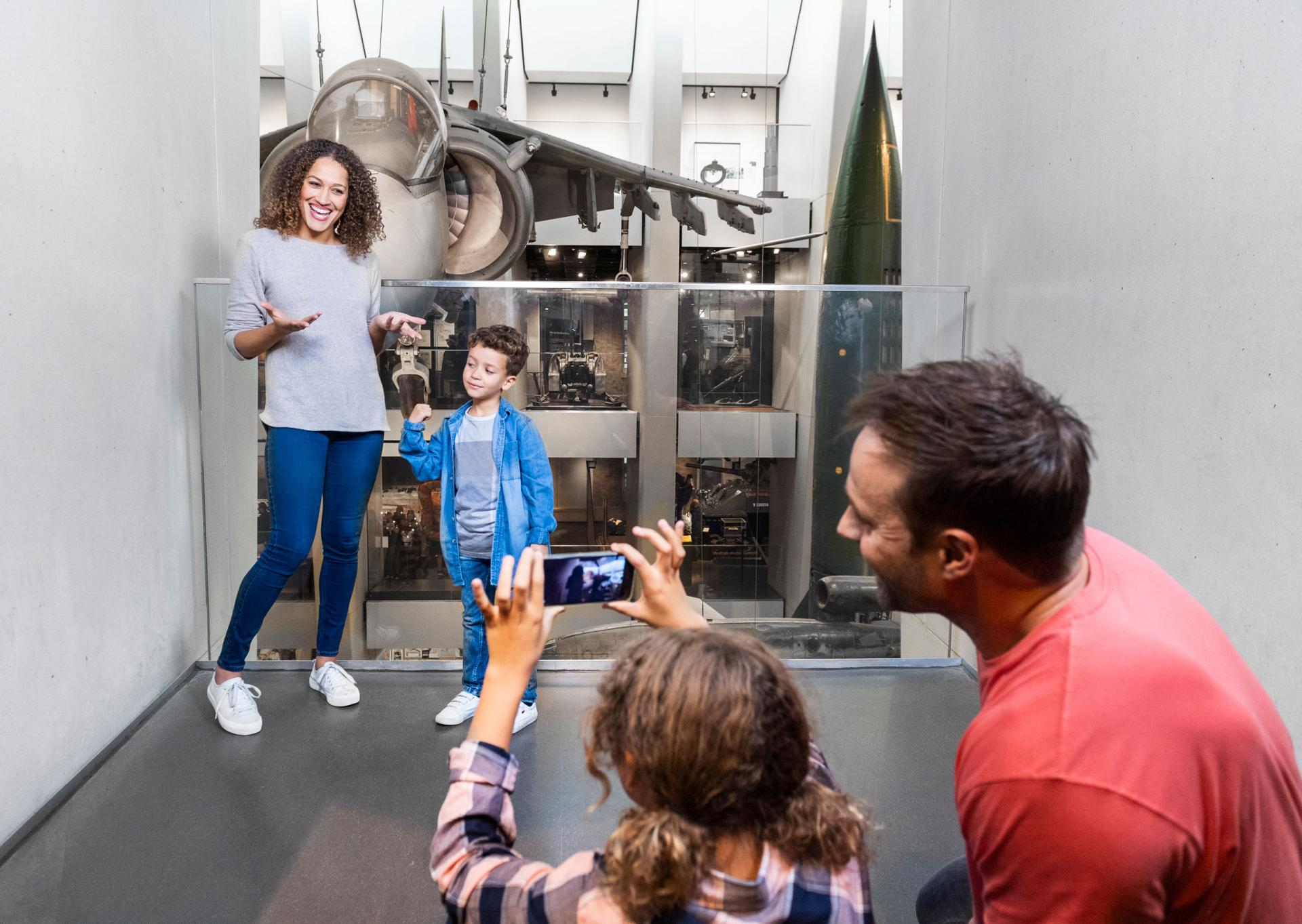 A family take part in the Documentary Challenge activity at IWM London.