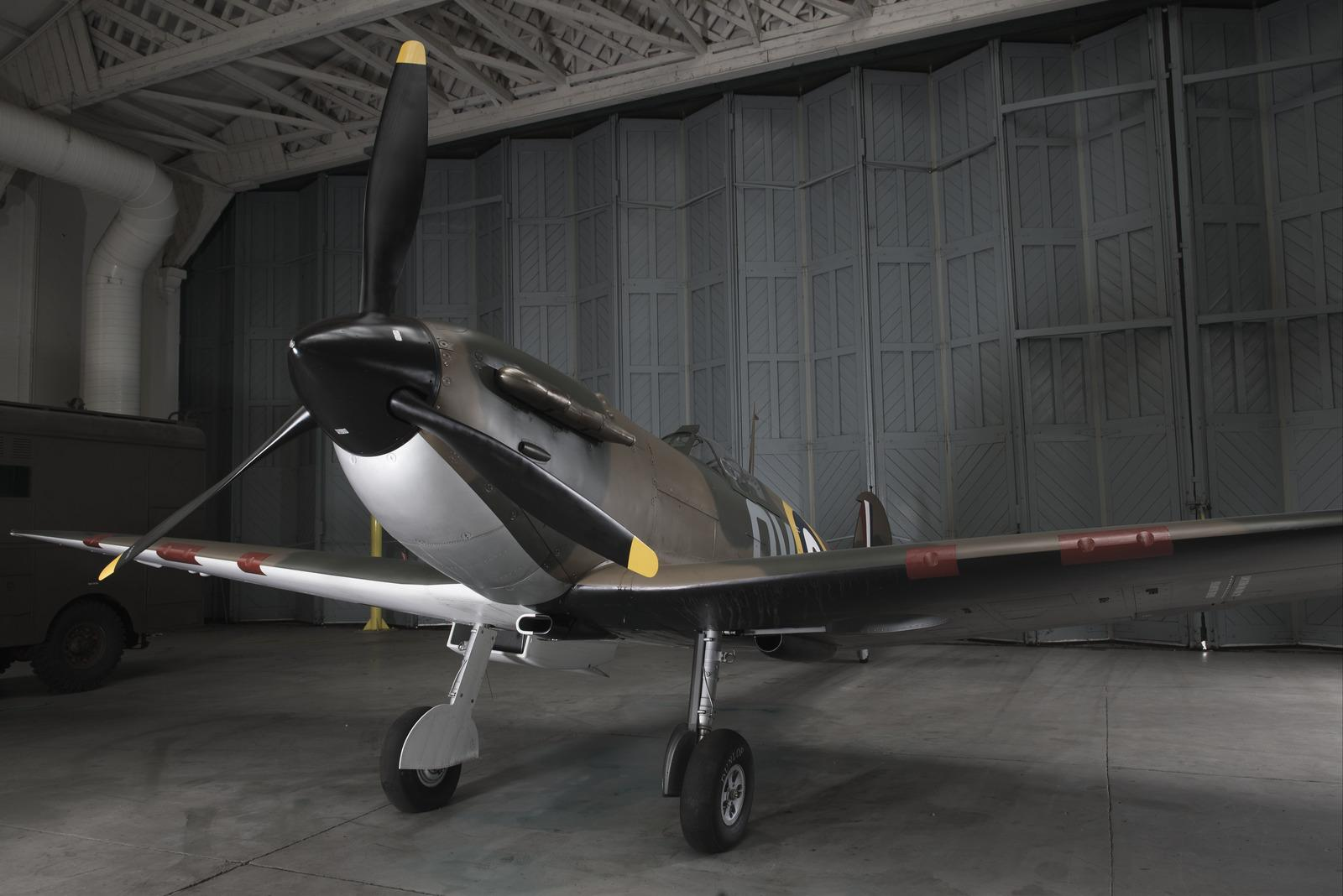 Photograph of Spitfire N3200, an airworthy combat veteran Spitfire in the Battle of Britain hangar at IWM Duxford