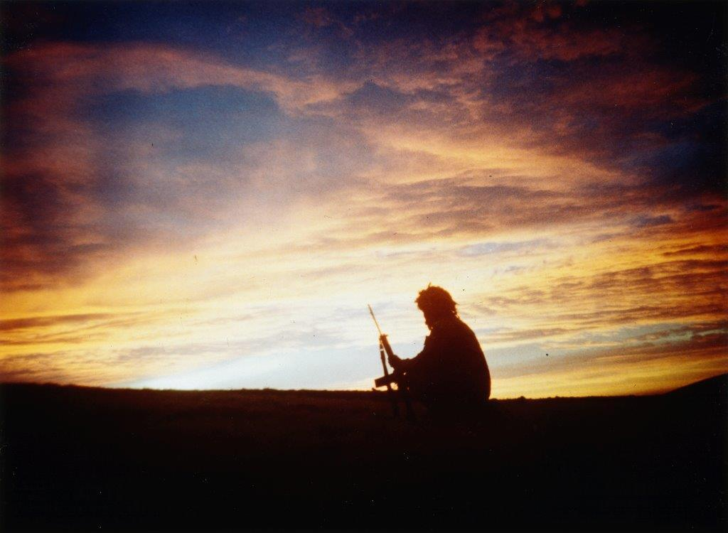 The Falkland Conflict: A soldier of 3 Battalion, Parachute Regiment silhouetted against the sunset at Windy Gap.© IWM FKD 2750