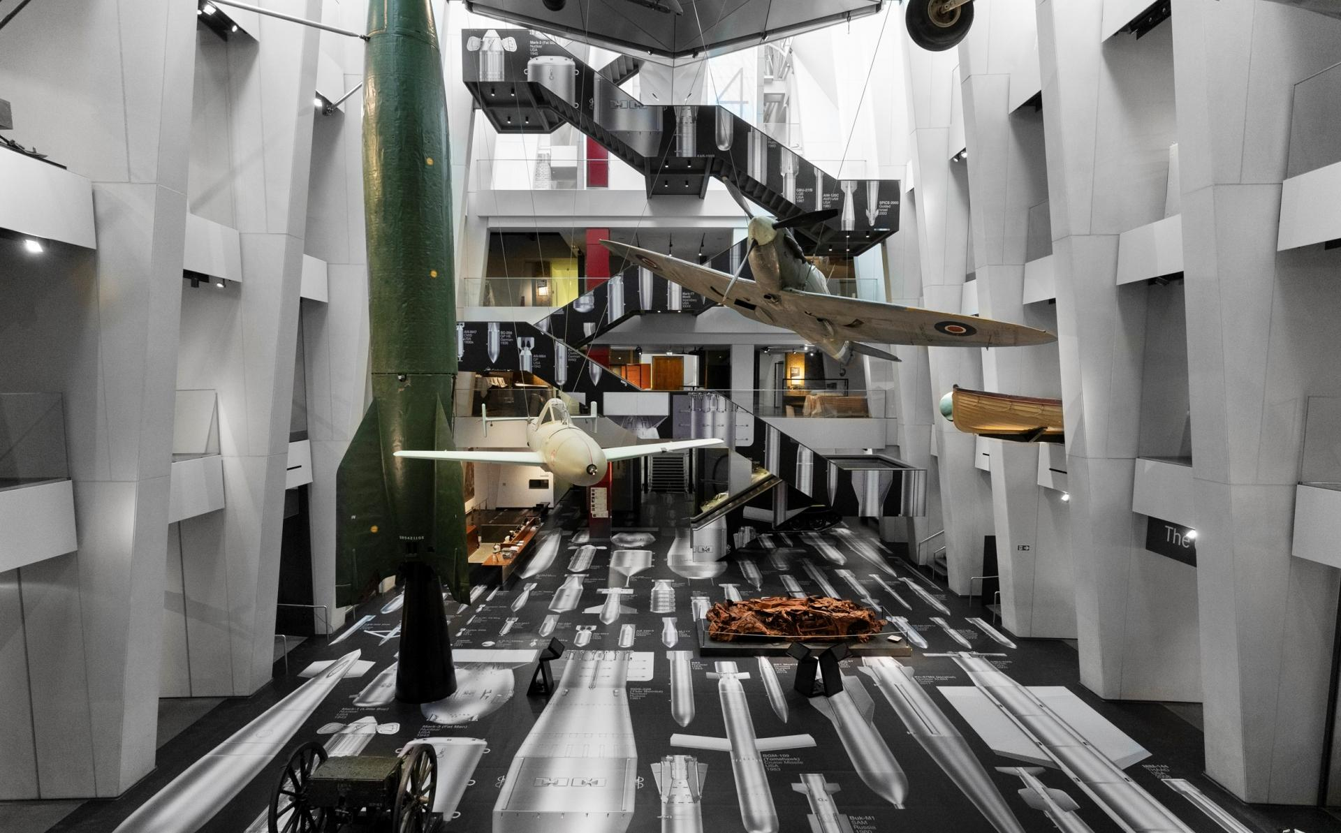 Atrium of IWM London featuring the artwork 'History of Bombs' by Ai Weiwei depicting the evolution of bomb design