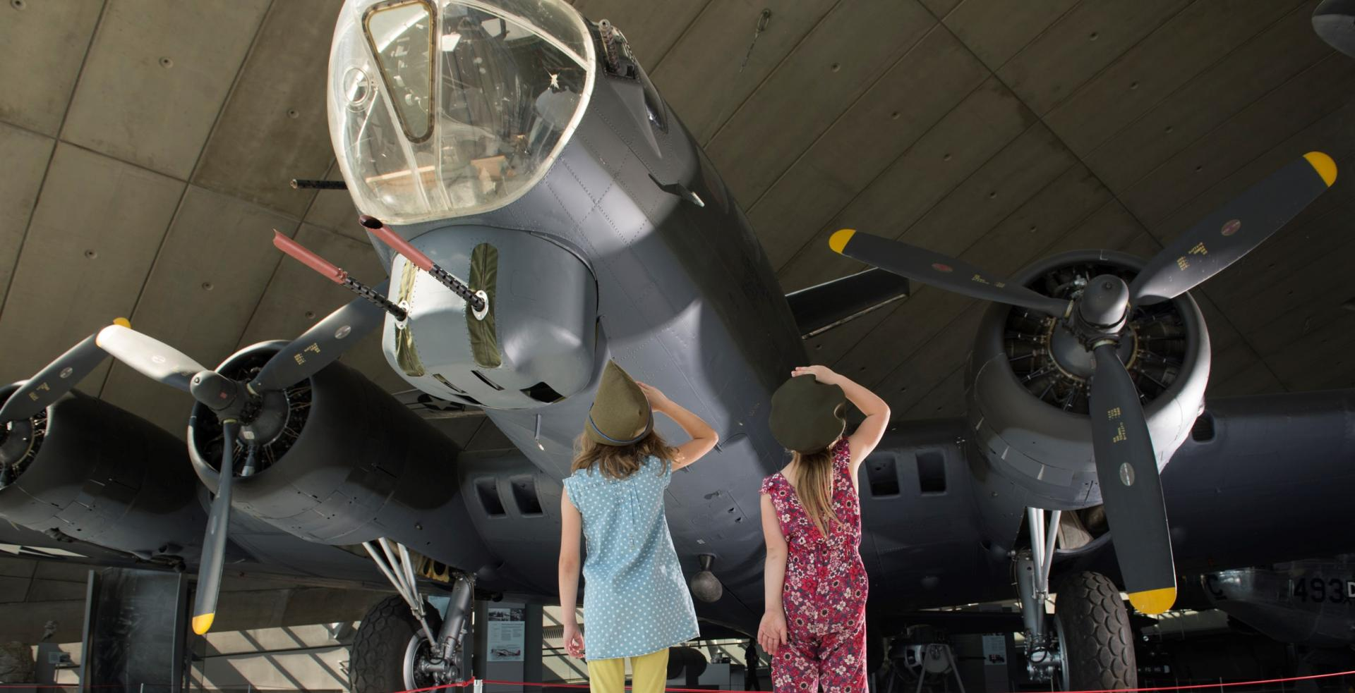 Two young visitors admire aircraft at IWM Duxford