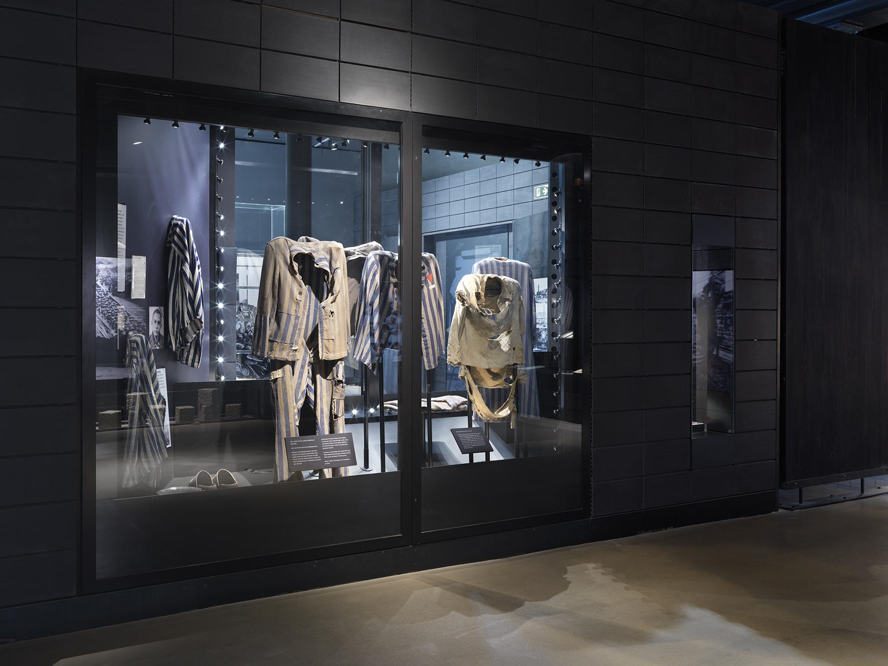 Holocaust Exhibition display case featuring concentration camp clothing
