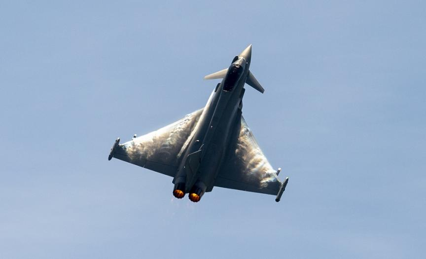 Typhoon FGR4 at speed, against a blue sky at Duxford Air Shows