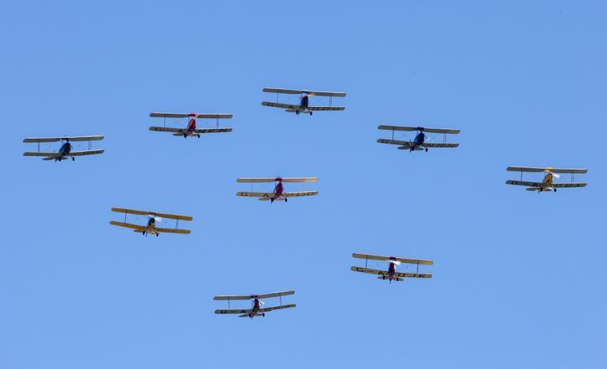Tiger 9 Display team against a blue sky, at Duxford Air Shows