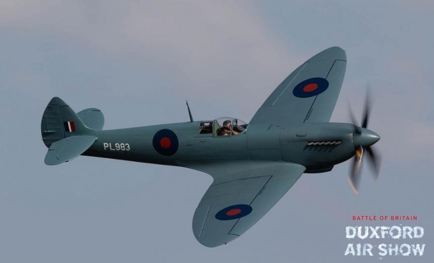 Spitfire PR Mk.XI in flight against a blue sky