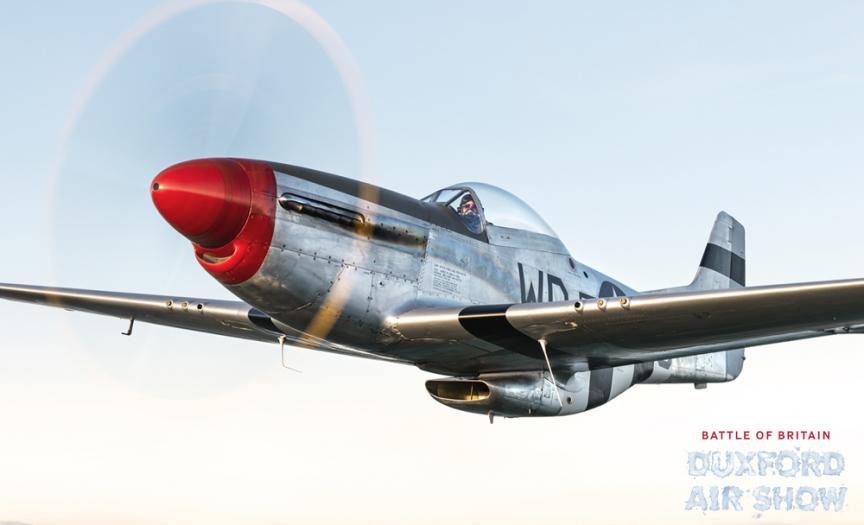 P-51D Mustang flying towards the camera at sundown