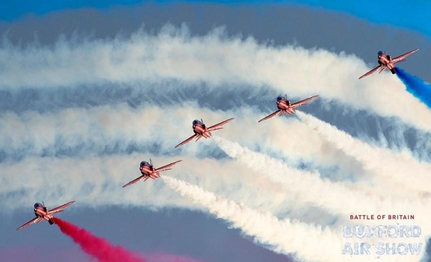 The Red Arrows with a smoky sky