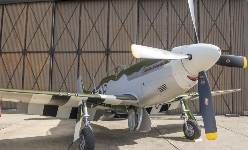 North American P-51D Mustang parked outside a hangar at IWM Duxford