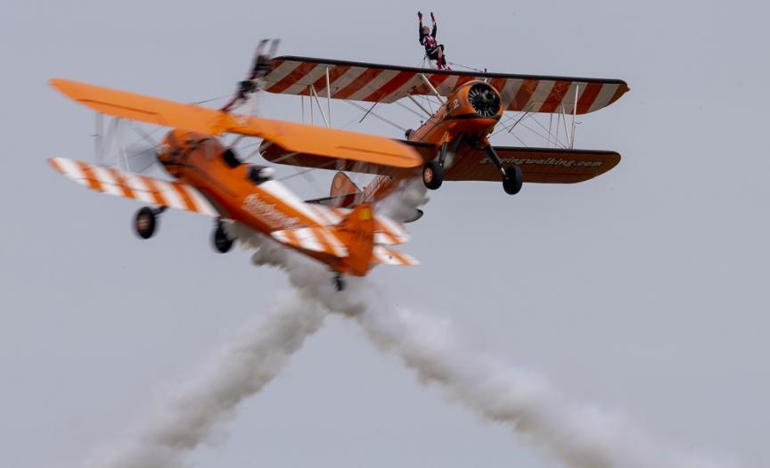 The Wingwalkers Stearman aircraft pass each other